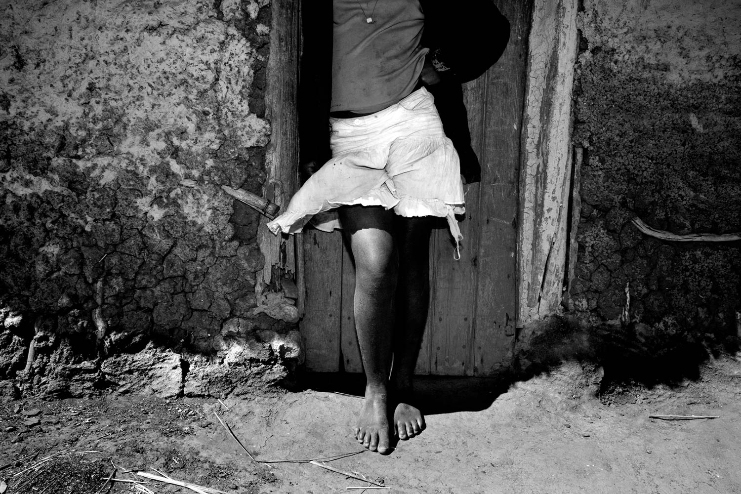 "A young girl wears a miniskirt in rural Swaziland. Western dress such as miniskirts has been deemed ""unSwazi"" and used to justify acts of physical abuse against young girls and women. A report commissioned by UNICEF and the CDC found that one in three girls has experienced sexual violence by age 18 in Swaziland."