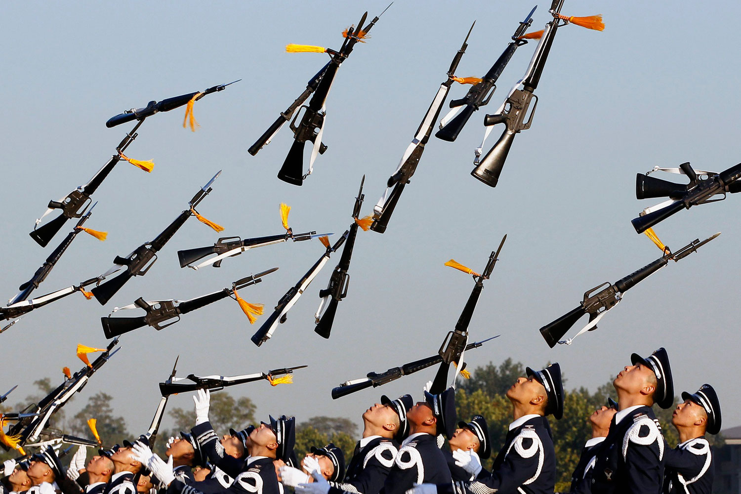October 18, 2011. South Korean honour guards perform during a welcoming ceremony for foreign military leaders visiting for the Seoul International Aerospace & Defense Exhibition 2011 at the Defence Ministry in Seoul.