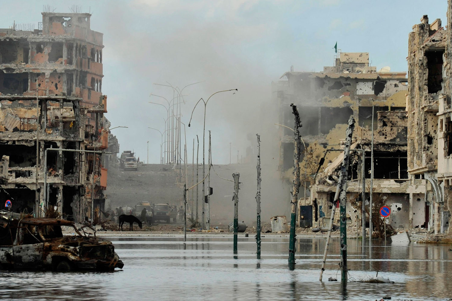 October 18, 2011. The view of a street after clashes between Libyan interim government forces and loyalists of Muammar Gaddafi in Sirt.