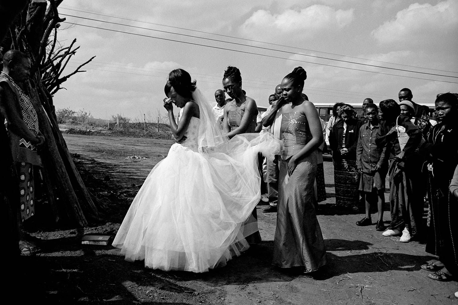 A young woman begins to cry before entering her new husband's homestead as she symbolically leaves her family behind in rural Swaziland. Swazi men are free to take as many wives as they would like as long as they can pay lobola, which is paid in cattle.