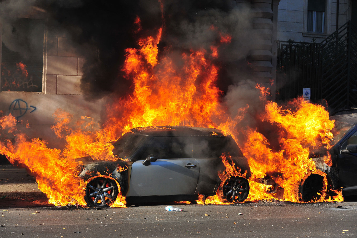 October 15, 2011. A car burns during a demonstration in Rome. Tens of thousands marched in Rome today as part of a global day of protests inspired by the  Occupy Wall Street  and  Indignant  movements, with the Italian capital under a security lockdown.