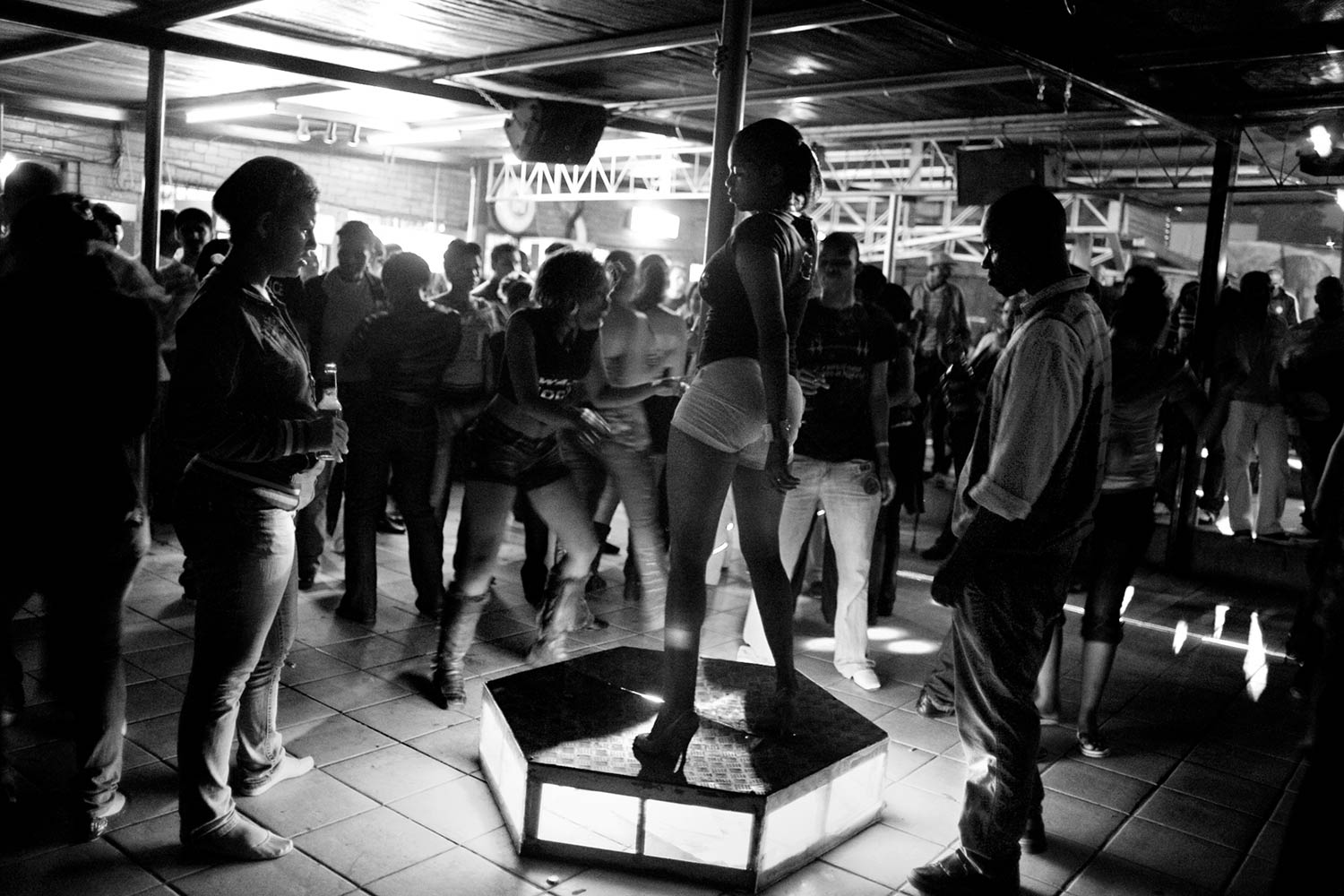 Young Swazi women and men party at a local nightclub in Manzini, Swaziland. Life expectancy in Swaziland has dropped from 61 to almost 31 over the past 10 years.