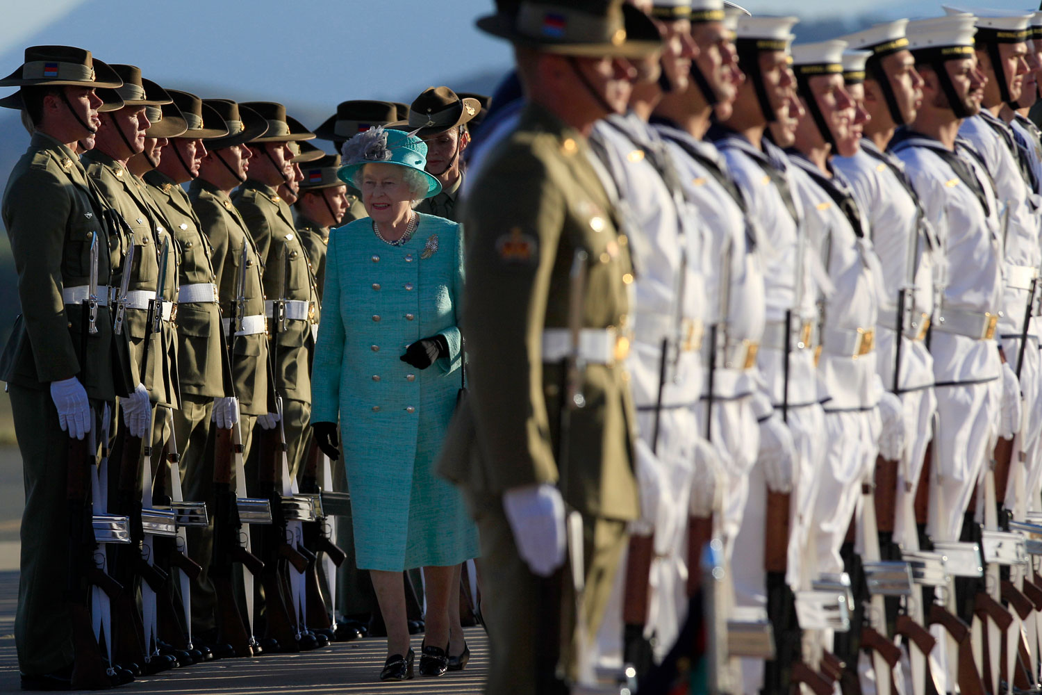 October 19, 2011. Queen Elizabeth II inspects an honor guard after her arrival at Fairbairn airforce base in Canberra. The Queen is on a tour to Australia, her first visit since 2006.