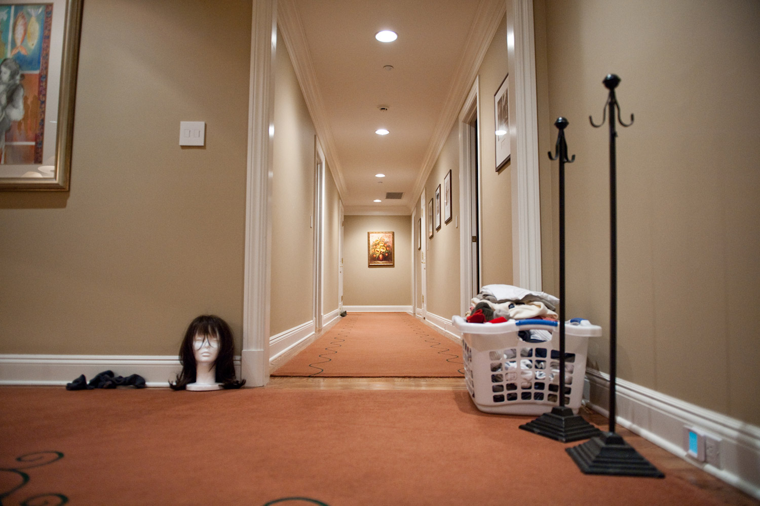 After cleaning the hallway of her home, Laurel Borowick notices that she had relegated the wig, which was once important to her, to the same level or importance as the laundry, April 2010.
