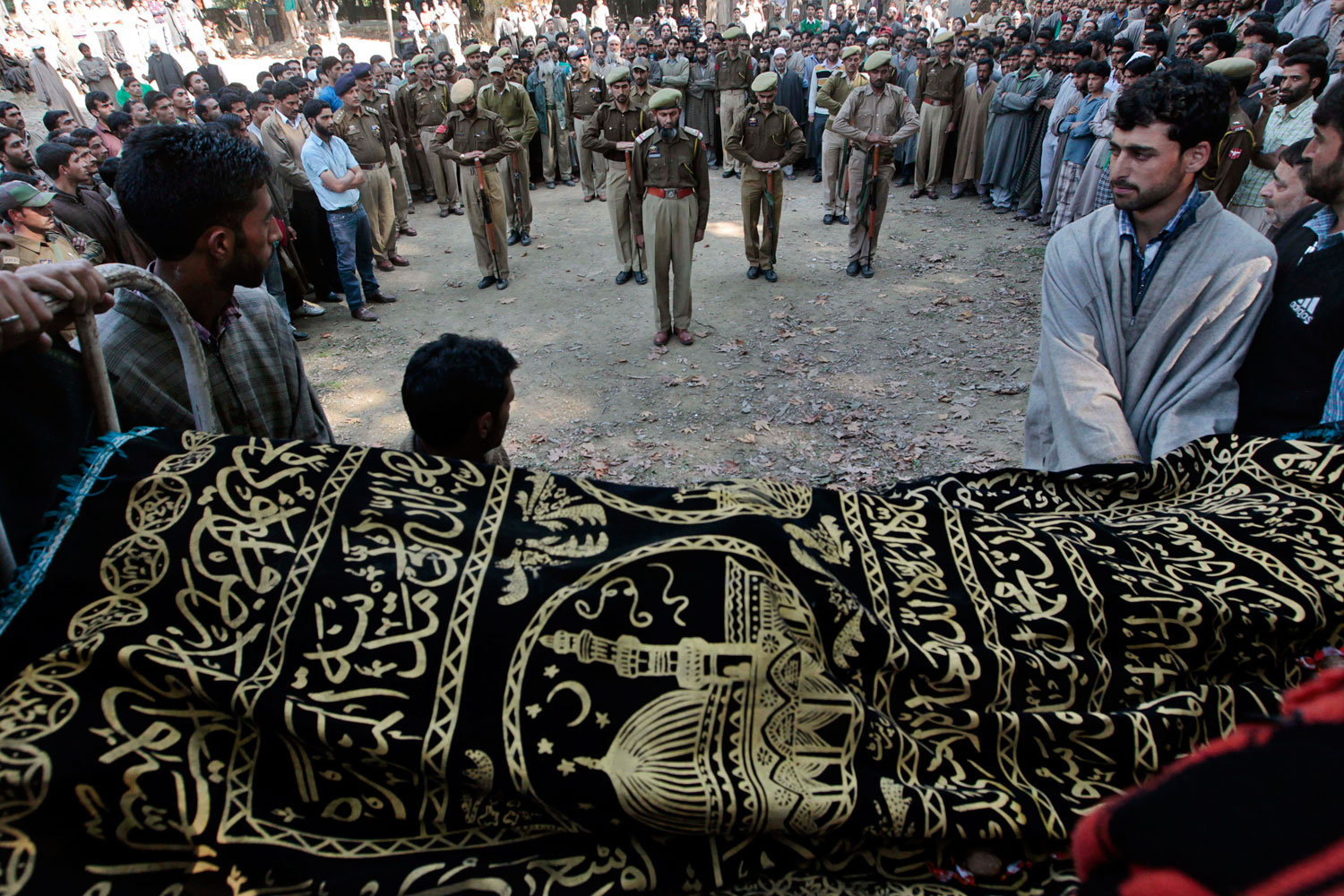 October 15, 2011. Police in Ghariand, India, pay their last respects to fellow officer Sajjad Ahmad Parray at his funeral procession. Parray died from wounds he sustained in a suspected militant attack a day earlier.