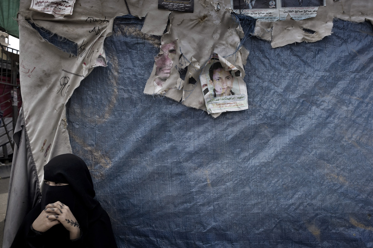 A Yemeni woman outside of a makeshift tent on September 29, 2011.