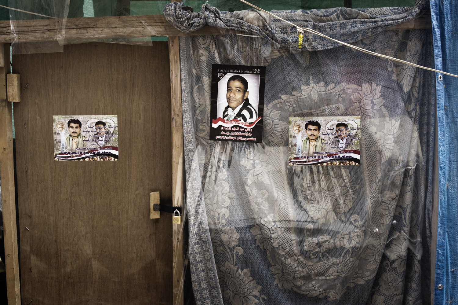 Posters of demonstrators killed during protests decorate makeshift housing in Change Square on September 29, 2011.