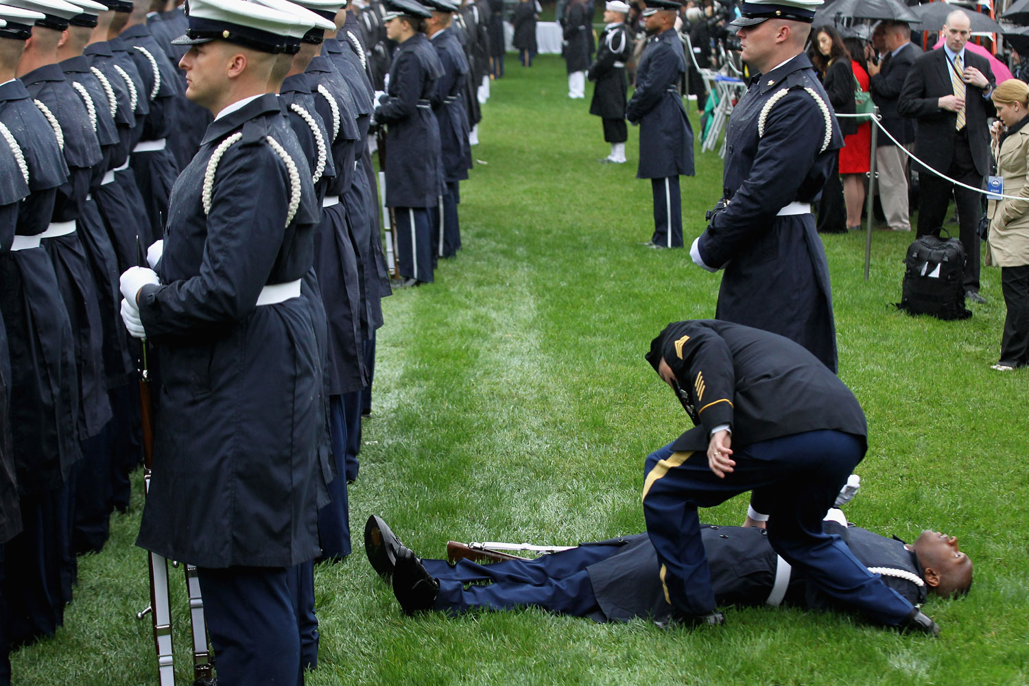 October 13, 2011. A member of the U.S. Coast Guard falls backwards during a welcome ceremony for President Lee Myung-bak of the Republic of Korea on the South Lawn of the White House in Washington, DC.