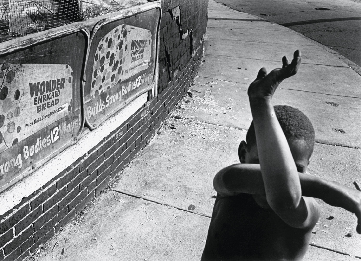 Wonder Bread, Dorchester, Massachusetts, by Eugene Richards, 1975/1997.                                   A great street picture that has some political overtones. It speaks of youth and the potential of life—I love the way his arms are criss-crossed in this funny little matrix. This is a picture full of wonder, and at the same time, dread of what the future is.