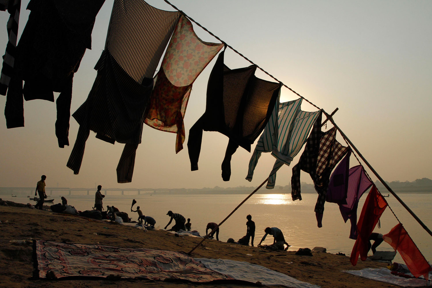 October 19, 2011. Indian washermen wash clothes at the banks of the River Yamuna on the outskirts of Allahabad, India.