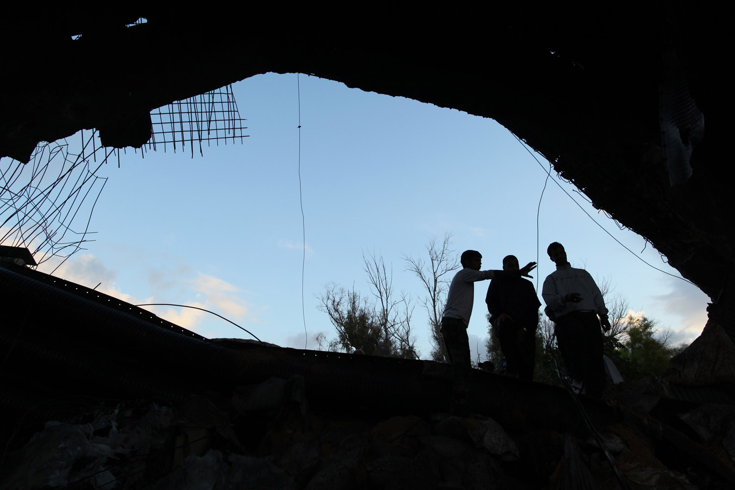 November 18, 2011. A Libyan mine-disposal team inspects damage after the controlled detonation of an unexploded NATO bomb at a military compound in Tripoli. Many Libyans hope the recent capture of Muammar Gaddafi's son Saif al-Islam Gaddafi may at last herald an end to hostilities.