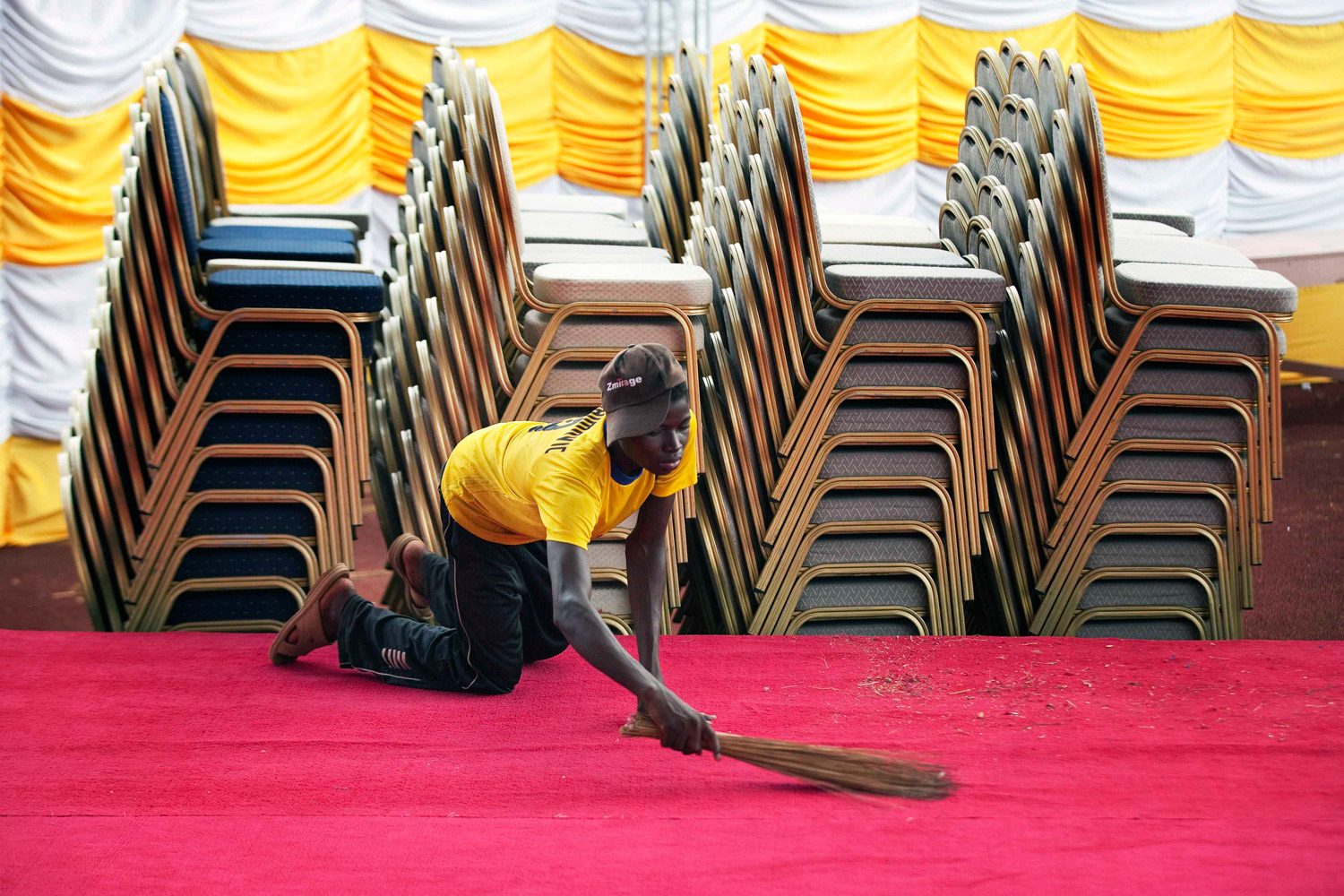 November 18, 2011. A worker sweeps the stage at the national stadium, ahead of a visit by Pope Benedict XVI to Cotonou. Africa is the Roman Catholic Church's fastest-growing region despite revelations of sex abuse and corruption scandals that have shaken followers in Europe.