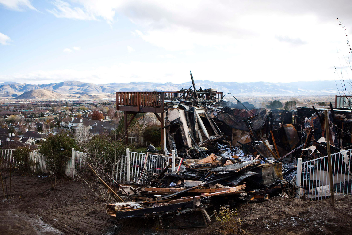 November 19, 2011. The remains of Joanna Irwin and Tim Galvin's burned home in Reno, Nevada. Nevada's governor declared a state of emergency over a wildfire raging at the edge of a hilly Reno suburb that has damaged 25 structures, forced 9,500 people from their homes and was blamed for an elderly man's death.