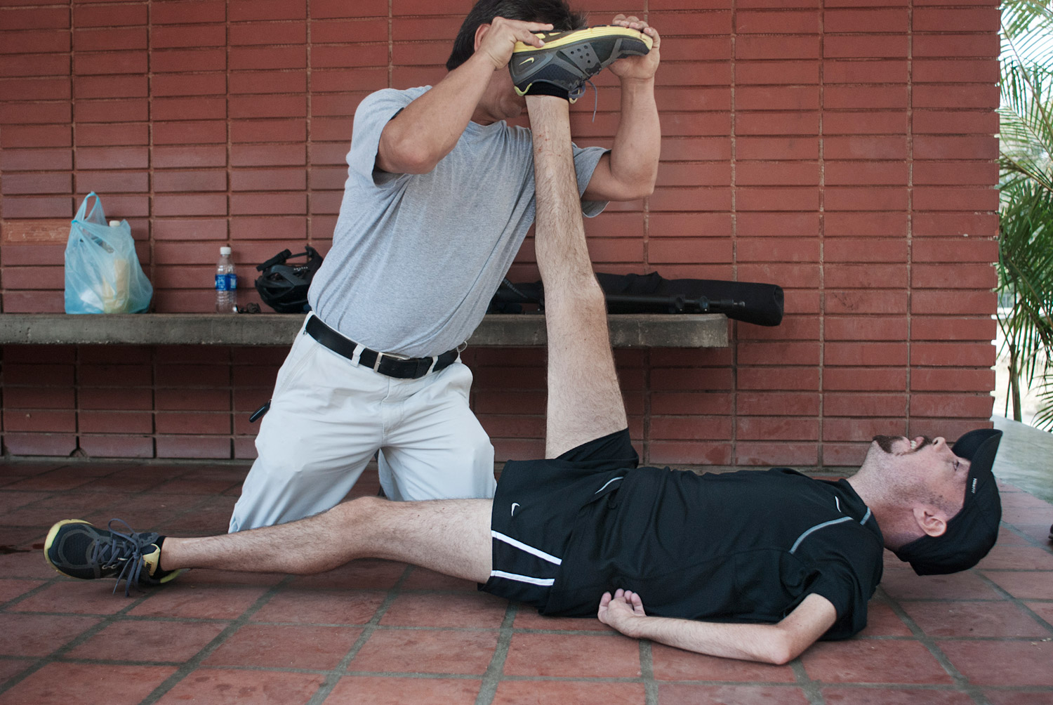Galo Bermeo, Melamed's assistant for the past 15 years, helps him stretch after two hours of training in March 2010.