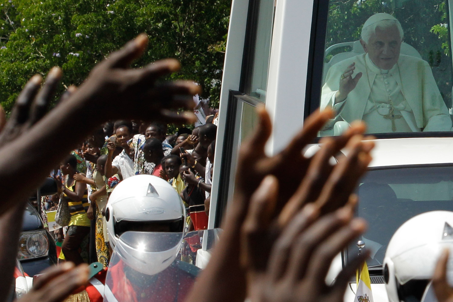 November 19, 2011. Pope Benedict XVI waves to the Catholic faithful as he arrives at the basilica in Ouidah, Benin. Pope Benedict XVI called on Africa's leaders to stop depriving their people of hope and to govern responsibly, just hours before he planned to unveil a pastoral guide for the continent which attempts to use church doctrine to address Africa's problems.