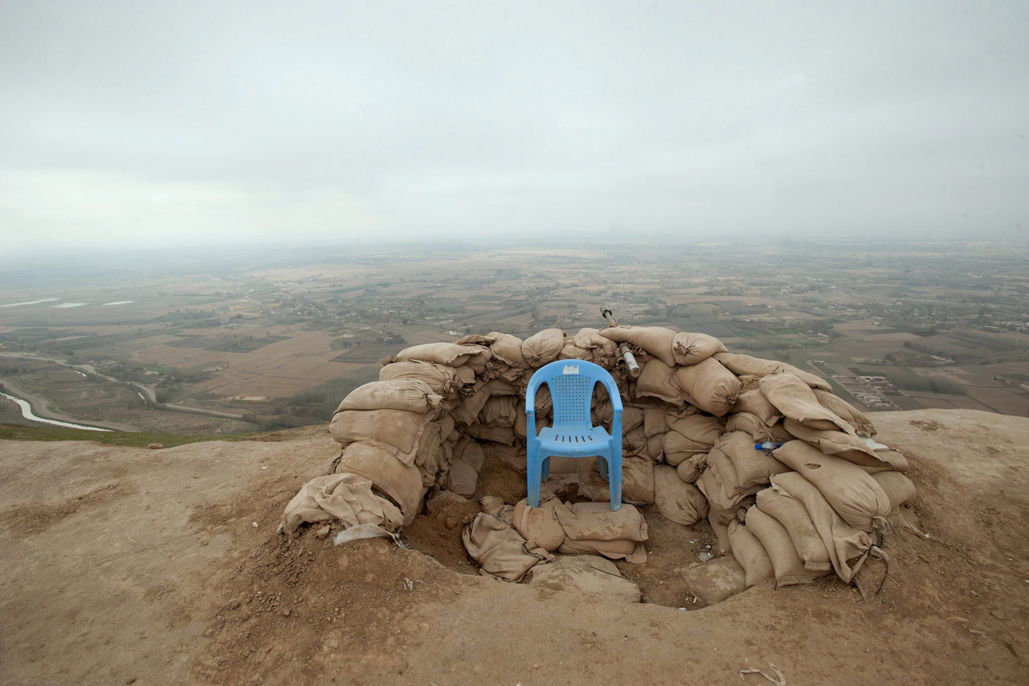 November 20, 2011. A chair sits unoccupied at what is supposed to be an observation post for the Afghan National Army near Pol-e Khomri in northern Afghanistan. Despite billions of dollars in U.S. aid, the Afghan army remains weak and divided.