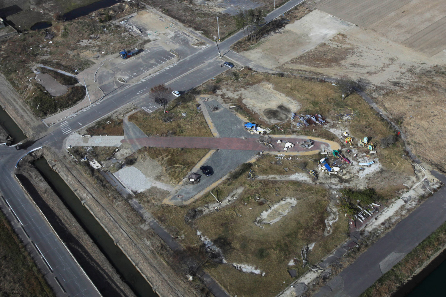 November 18, 2011. Debris scattered across the outline of a jet marking Sendai airport on Japan's eastern coast serves as a lingering sign of the tsunami and earthquake that hit the country in March. Eight months after the twin disasters, the Japanese economy is finally showing signs of recovery.