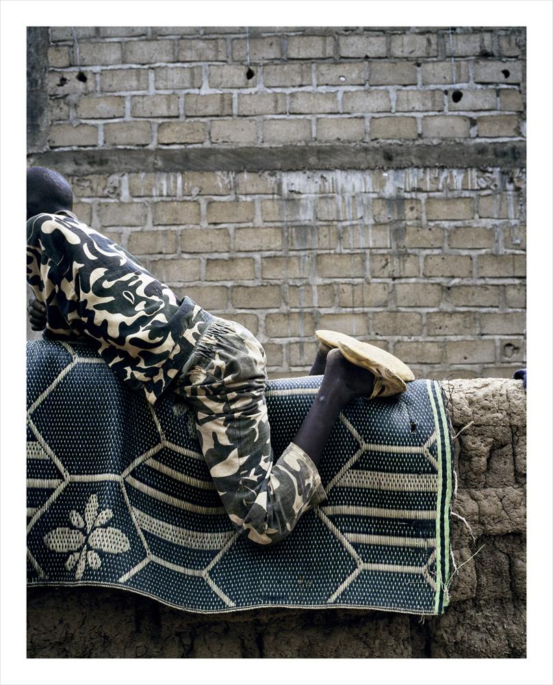 Boy on wall, from Moi, Un Blanc series, Mali, 2010