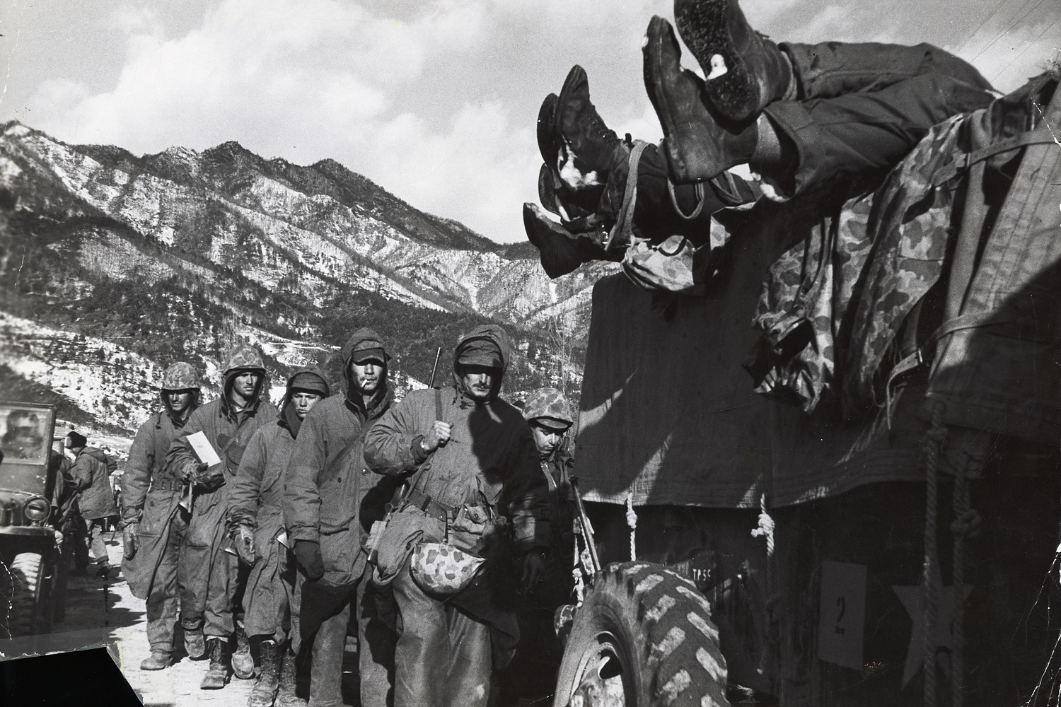 Dead U.S. marines loaded in a truck, leading a column of survivors during their grim retreat from the Changjin Reservoir after being cut off by the Red Chinese in December of 1950.