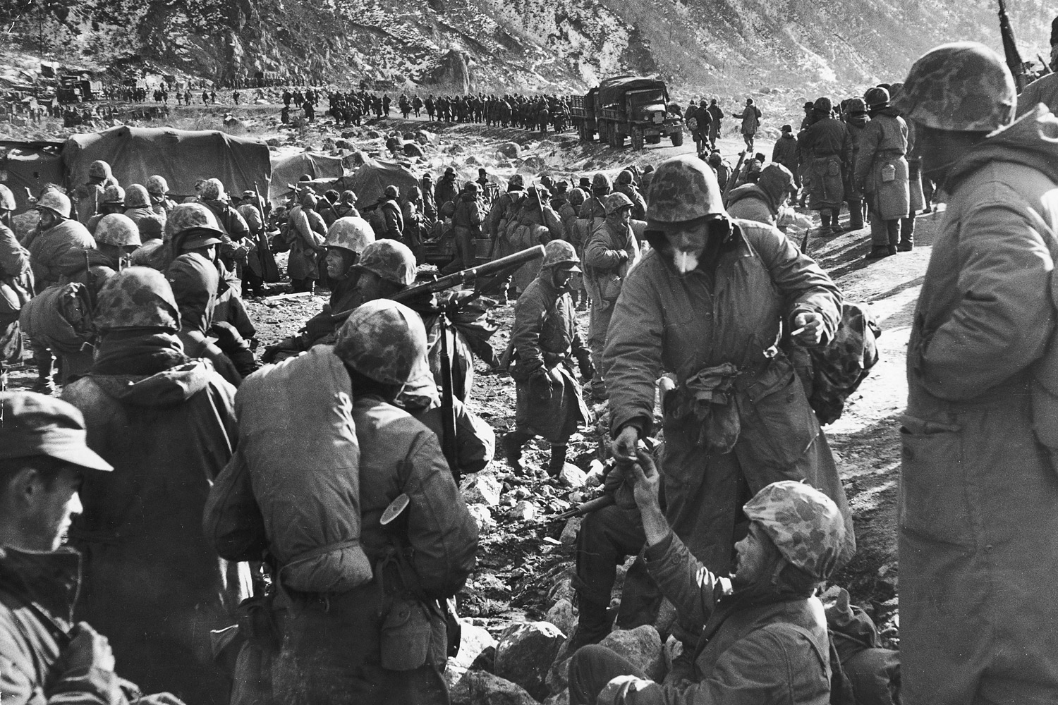 U.S. Marines of 1st Division resting after making it  through canyon road known as  Nightmare Alley  during their retreat from the Changjin Reservoir in December 1950.