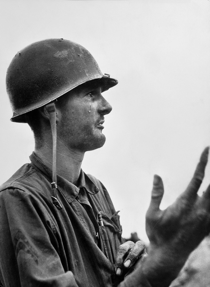 U.S. Marine Corporal Leonard Hayworth shedding tears of frustration after finding out his unit was out of ammunition and he had lost all but two men in a firefight with North Korean forces in August 1950.