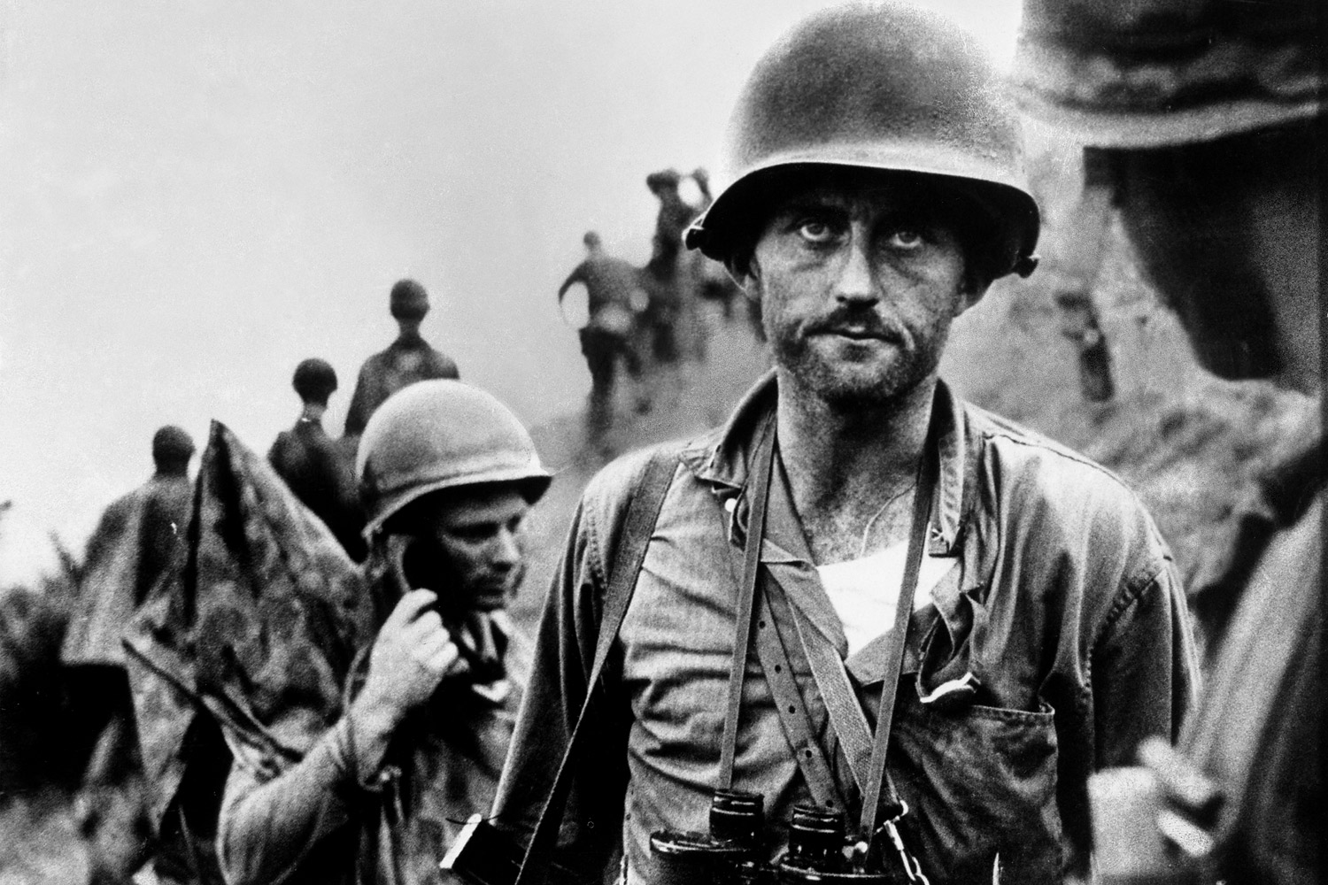 Marine Capt. Francis Ike Fenton looking grim after learning his first sergeant was killed and his unit is out of ammunition during a heavy North Korean counterattack along the Naktong River in August 1950.