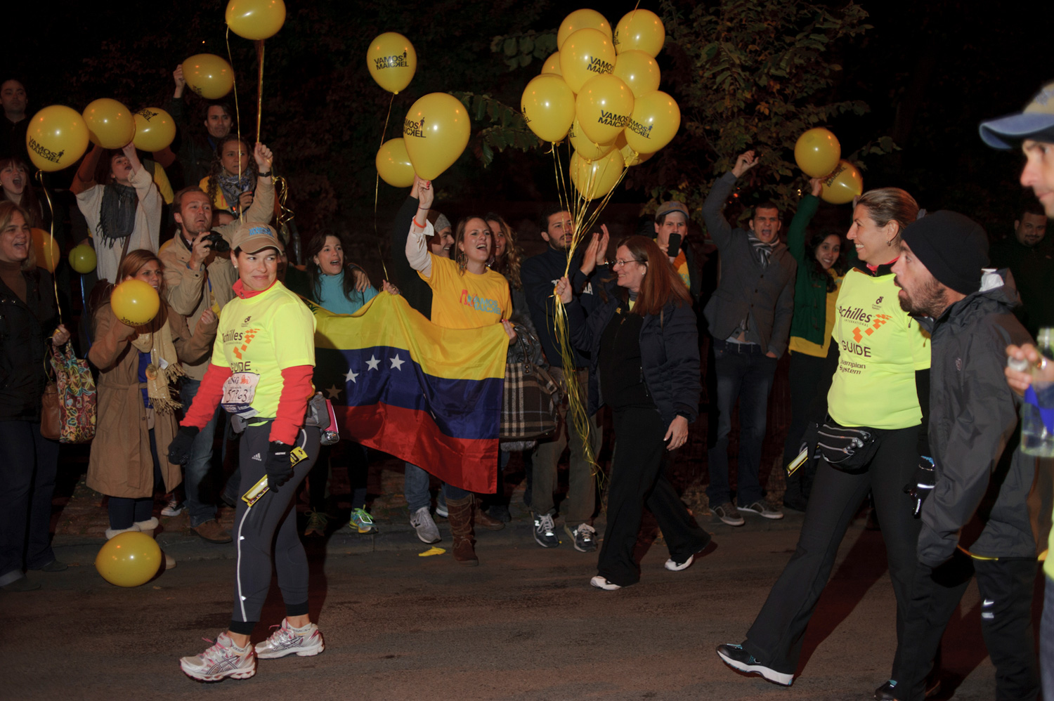 Melamed's friends, colleages and family cheer him on near the end. He completed the Nov. 6 race at 11:50 p.m., 15 hours and 22 minutes after he began. Nearly 350 people were waiting for him as he crossed the finish line.