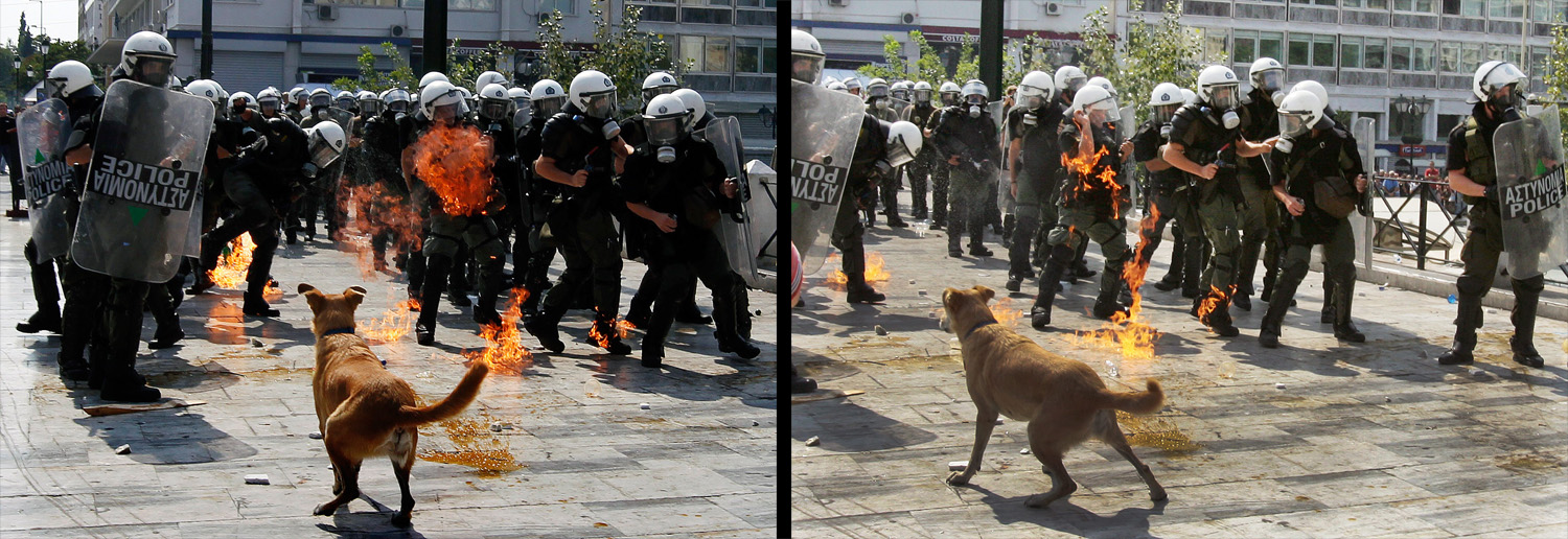 October 5, 2011. Riot police officers try to avoid a molotov cocktail bomb hurled by protestors during a demonstration in central Athens, Greece. Civil Servants' Supreme Administrative Council (ADEDY) and General Confederation of Workers of Greece (GSEE), Greece's two largest umbrella federations representing the public and private sector staged a 24-hour nationwide strike protesting against the ongoing austerity measures taken by the Greek government.