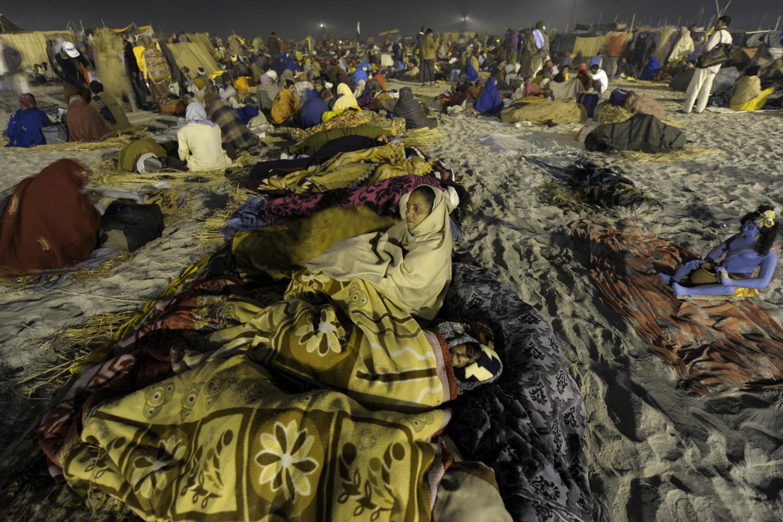 January 13, 2011. Indian Hindu pilgrims sleep at the Gangasagar fair ground some 180 kms south of Kolkata. A large number of Hindu pilgrims converged on the occasion of Makar Sankranti, a holy day of the Hindu calendar.
