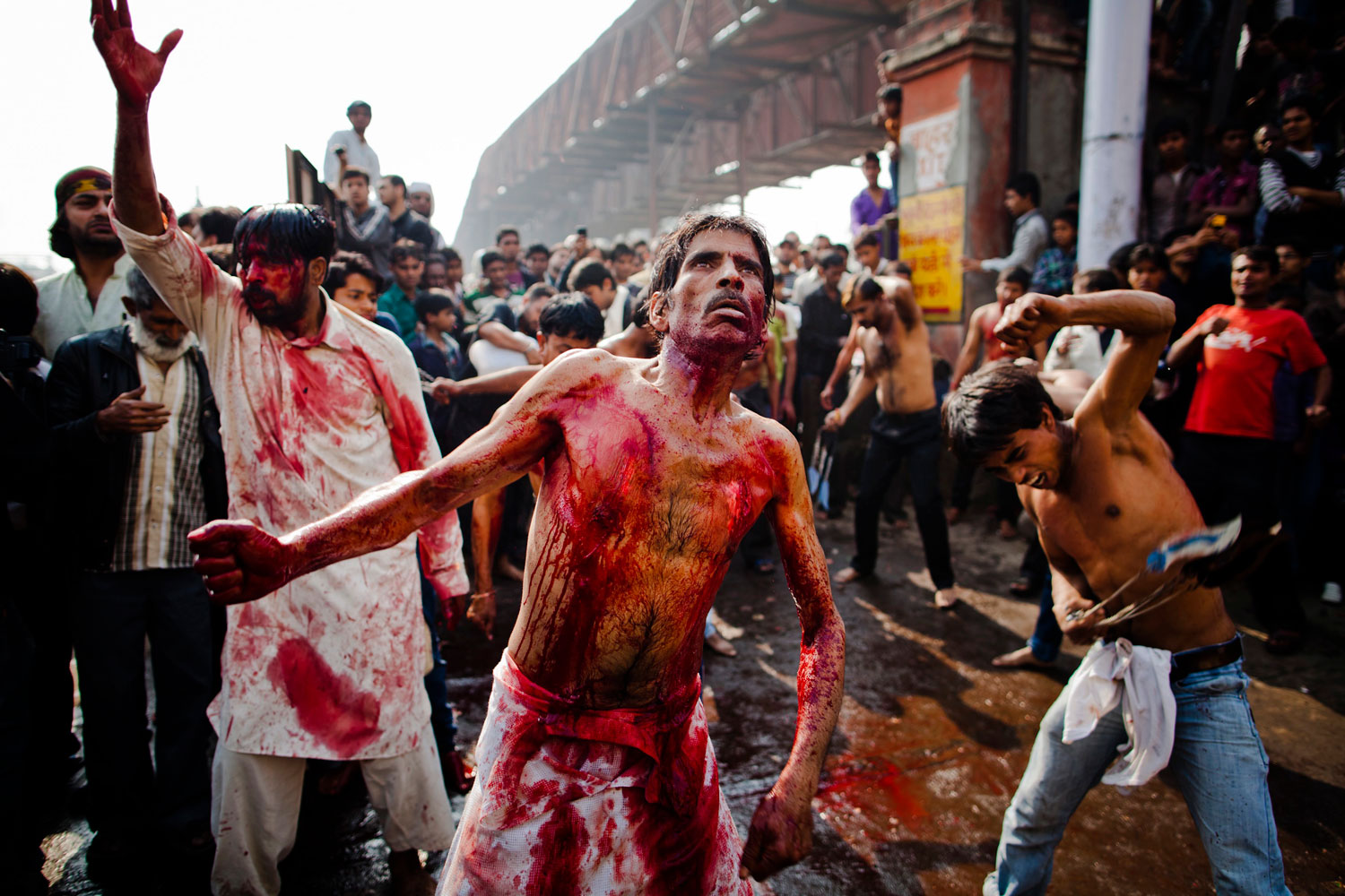 December 6, 2011. Shi'ite Muslim men and boys beat their chests as they practice self-flagellation during the religious ritual of Ashura in New Delhi, India. Hundreds of Muslims in New Delhi and thousands around India took part in a procession to mark the 10th day of the Islamic month of Muharram.