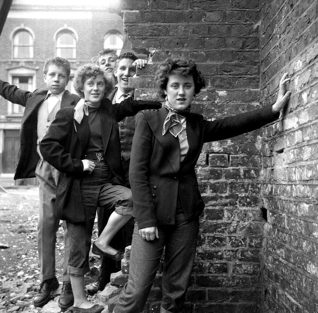 Rose Hendon and Mary Toovey pose with unknown young Teddy Boys in Southam Street. Rosie left school that year to go and work in a McVities biscuit factory.