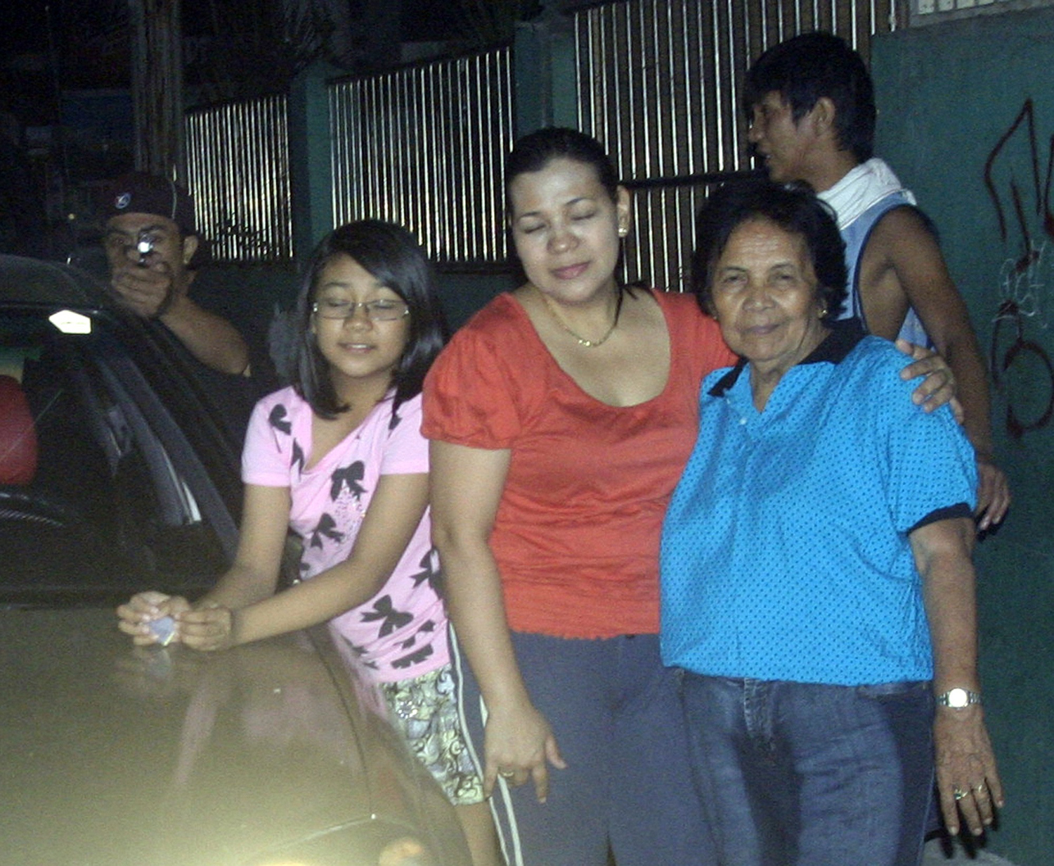 Seconds after taking this picture of his smiling family outside his Manila home, in the early hours of New Years day, councilman Reynaldo Dagsa was shot dead. The police did not have to look far for evidence of the killer's identity. The assassin and his accomplice had inadvertently been photographed in the background of the last image taken by the politician—his gun directly aimed at his victim—from behind a parked car, the barrel highlighted by the camera's flash.                                                              Amid the traditional exploding firecrackers Dagsa's relatives had not heard the gunshot that killed him-- they simply saw him collapse after he was hit. He was rushed to hospital but pronounced dead on arrival. Later when they looked at the photo he had taken of them, his family realized that the 35-year-old Dagsa had photographed his own murder in the act.                                                              The photograph, taken just after midnight on 1 January, was released by Dagsa's family on 4 January. It was published on the front page of The Philippine Daily Inquirer and then quickly went viral. The picture also led to the arrest of two suspects, gunman Michael Gonzales and accomplice Rommel Olivia.