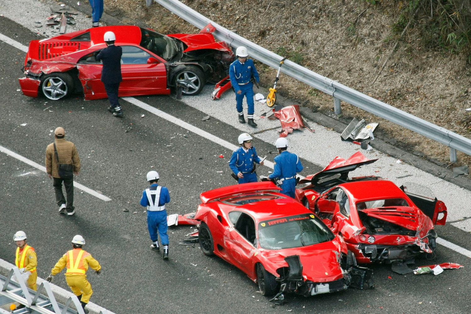 December 4, 2011. Police officers investigate wrecked luxury cars at the site of a traffic accident on the Chugoku Expressway in Shimonoseki, southwestern Japan. Ten people were slightly injured in the pile up involving eight Ferraris, a Lamborghini, two Mercedes-Benz and two Japanese cars, according to the police. A group of luxury sports car fans were believed to be driving together when the accident occurred.