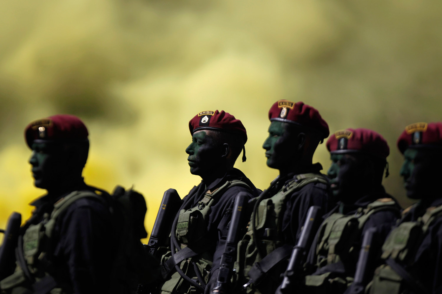 December 5, 2011. Kaibiles, members of Guatemala's special‑operations forces, take part in a ceremony to mark their graduation from a harsh training course. The controversial counterinsurgency unit within the Guatemalan army was founded in 1974; just nine soldiers successfully completed the course.