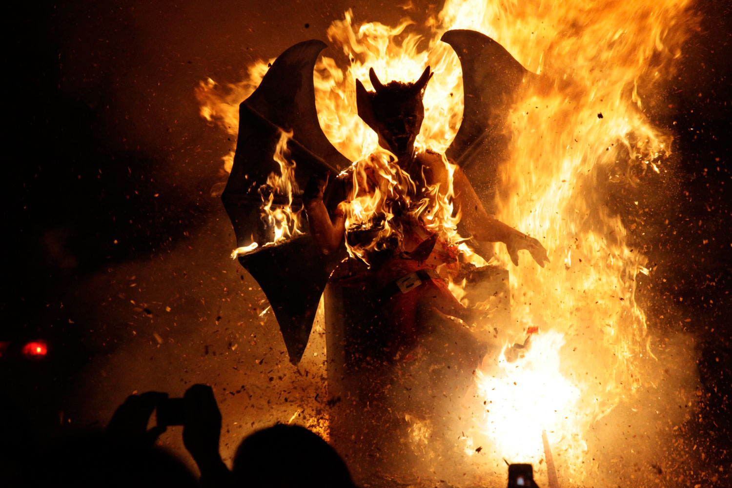 December 7, 2011. A five-metre (16 feet) replica of a devil burns during a  Quema del Diablo  (burning of the devil) ceremony in Antigua, 217 km (135 miles) off Guatemala City. Locals believe that the devil symbolizes evil and negativity, and burning its replica would alleviate them of these problems. However, environmental groups have condemned the ceremony, saying it is a source of air pollution, while religious groups have considered this a form of devil worship.