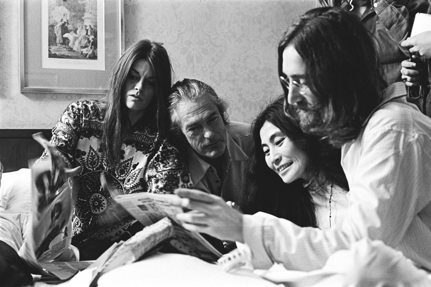 Rosemary and Timothy Leary, with Yoko Ono and John Lennon reading the local paper about their  Bed-In.