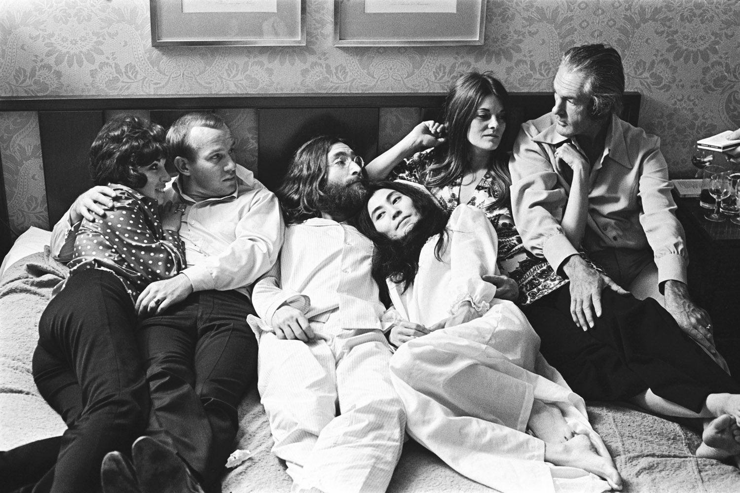 The following photographs are previously unseen images of John Lennon and Yoko Ono during their  Bed In  for peace at Montreal's Queen Elizabeth Hotel in June 1969. Here, Tommy Smothers, an unknown friend, John Lennon, Yoko Ono, Rosemary Leary and Timothy Leary.