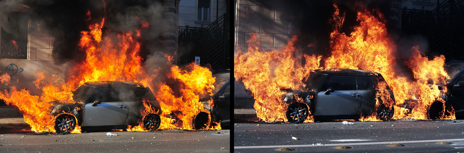October 15, 2011. A car burns during a demonstration in Rome. Tens of thousands marched in Rome today as part of a global day of protests inspired by the  Occupy Wall Street  and  Indignant  movements, with the Italian capital under a security lock-down. Protesters launched worldwide street demonstrations on October 15 against corporate greed and biting cutbacks in a rolling action targeting 951 cities in 82 countries.
