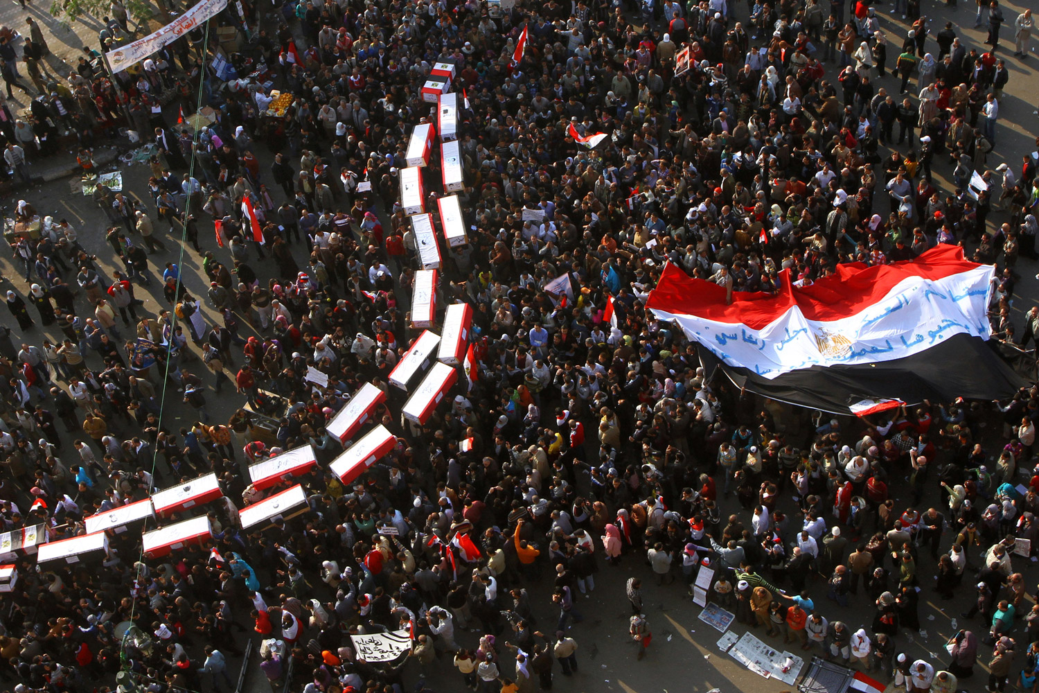 December 2, 2011. Egyptian demonstrators carry mock coffins in memory of fellow protesters who were killed during deadly clashes with security forces as they take part in a rally at Tahrir Square in Cairo.