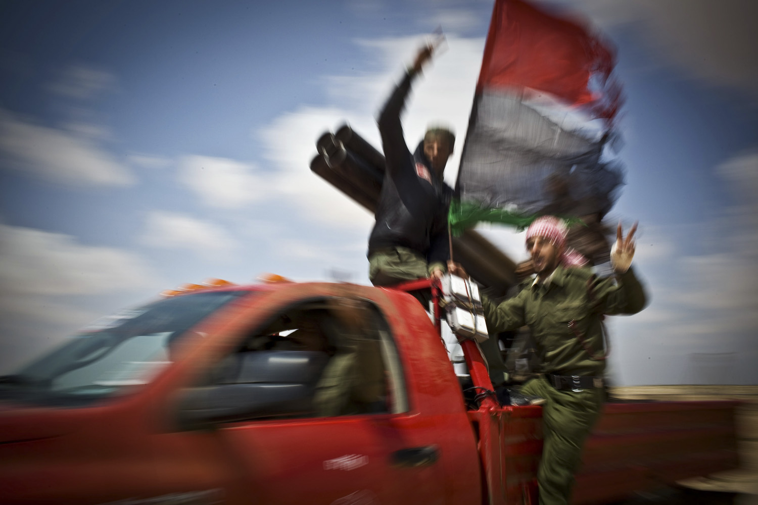 Anton Hammerl's picture of anti-Gaddafi freedom fighters outside the recaptured town of Brega, taken in Libya on April 3, 2011.
