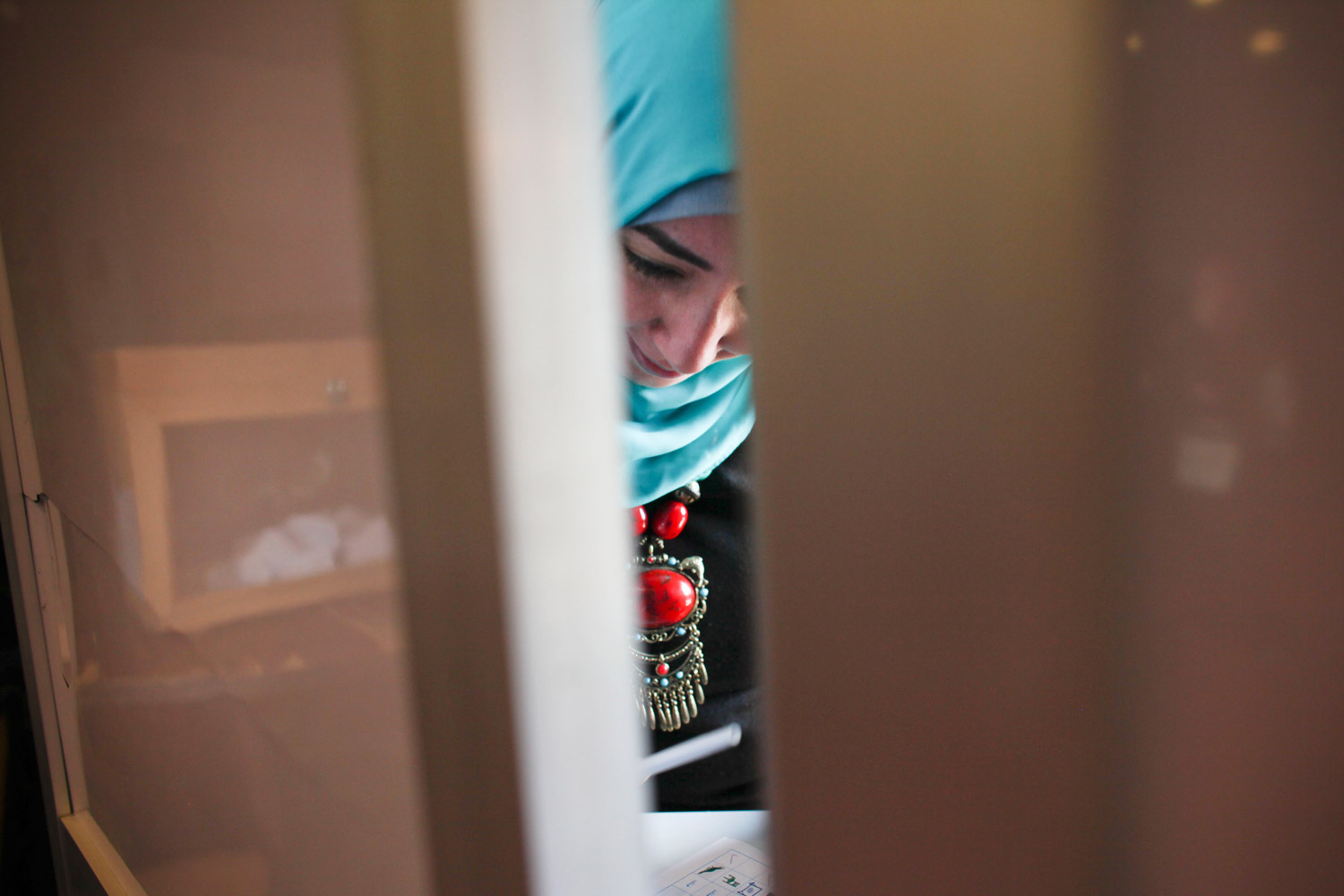 December 5, 2011. An Egyptian woman votes inside a polling station in Nasr City, a neighborhood of Cairo, Egypt.