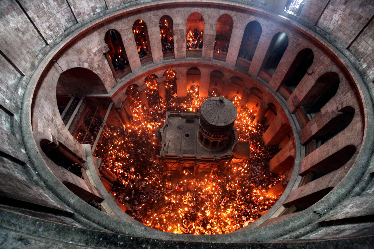 April 23, 2011. An aerial view from the rotunda inside the Church of the Holy Sepulchre in Jerusalem that shows the Tomb of Christ as the miracle of the Holy Fire occurs the day before Easter.