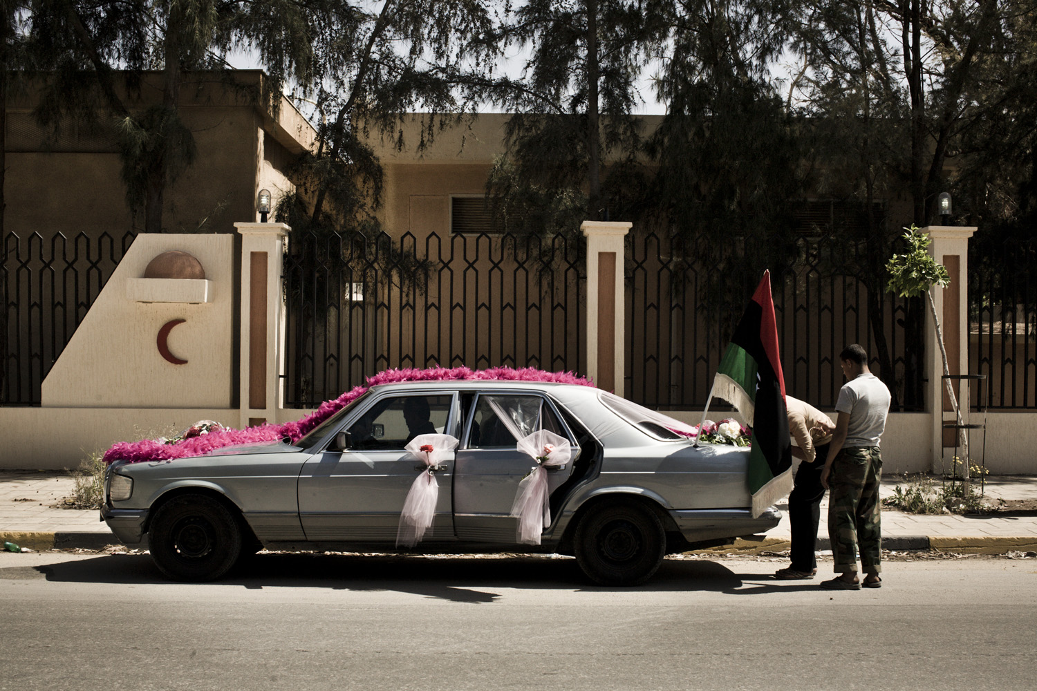April 14, 2011. A car being prepared for a wedding ceremony in Benghazi, Libya.