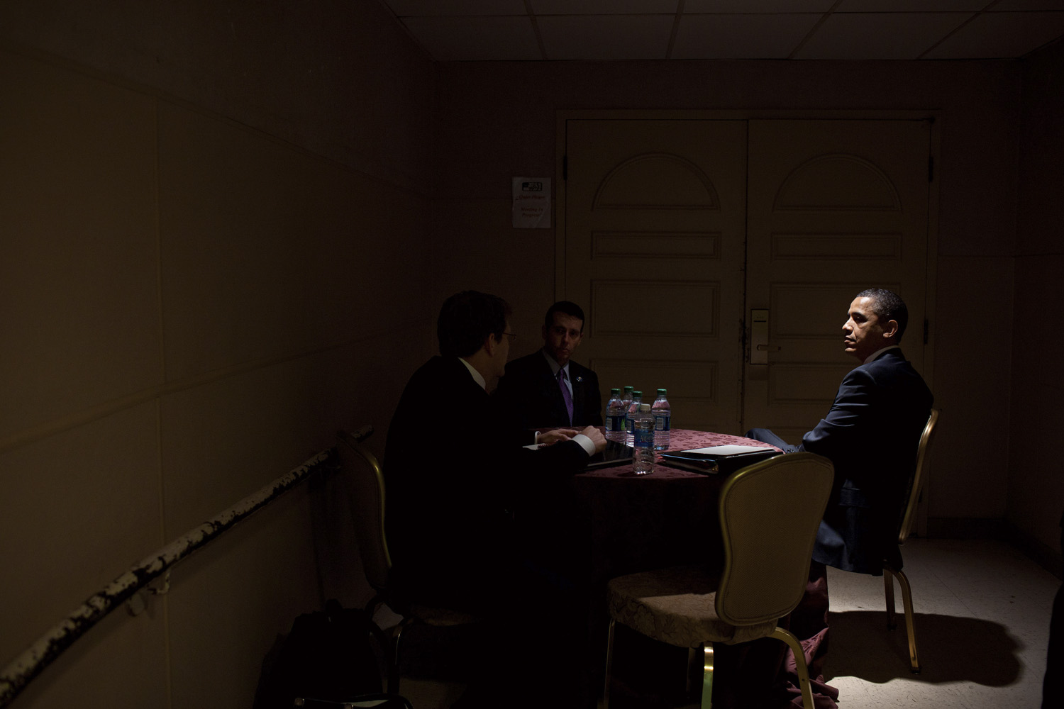 April 15, 2011. President Barack Obama meets with Press Secretary Jay Carney, left, and Senior Advisor David Plouffe, center, before an interview with Ben Feller of the Associated Press, in Chicago, Illinois.