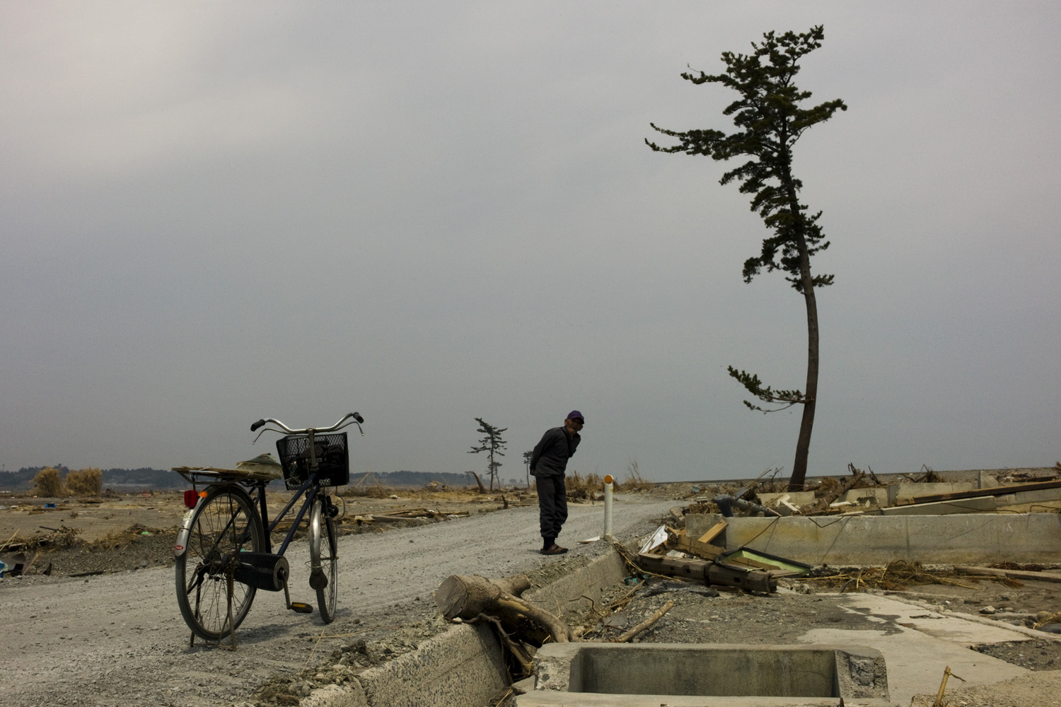 April 16, 2011. An old Japanese man surveys the area devastated by a March earthquake and tsunami.