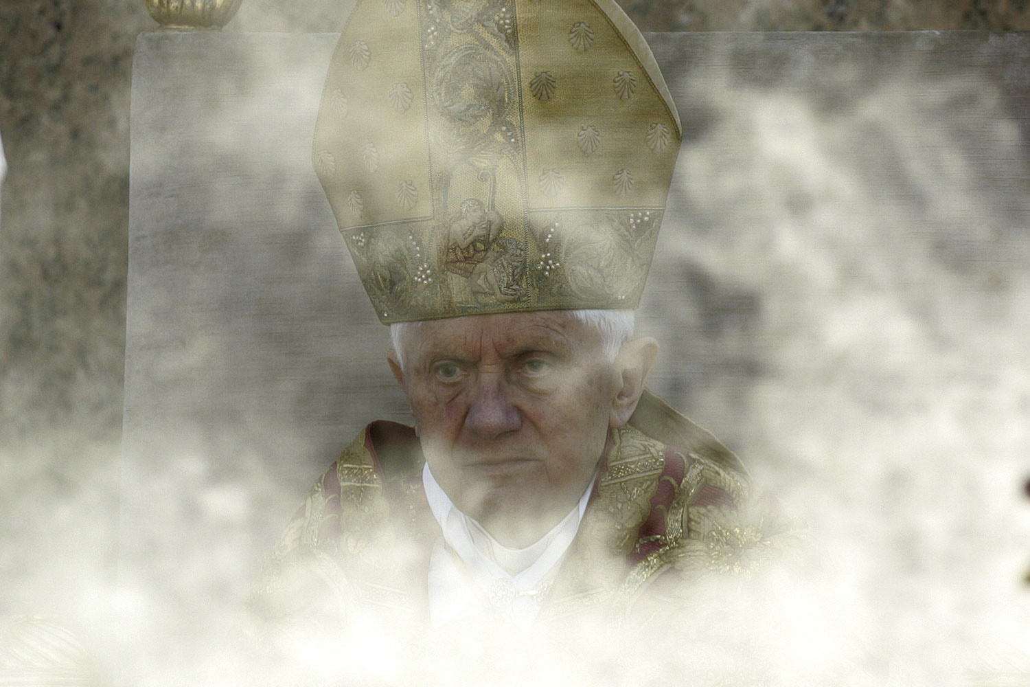 April 17, 2011. Pope Benedict XVI peers through incense during the liturgical celebration of Palm Sunday in St. Peter's Square in Rome, Italy.