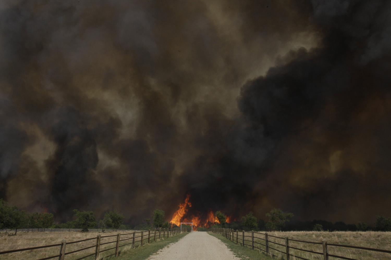 April 19, 2011. Smoke rises from an uncontrolled wildfire burning near Possum Kingdom, Texas.