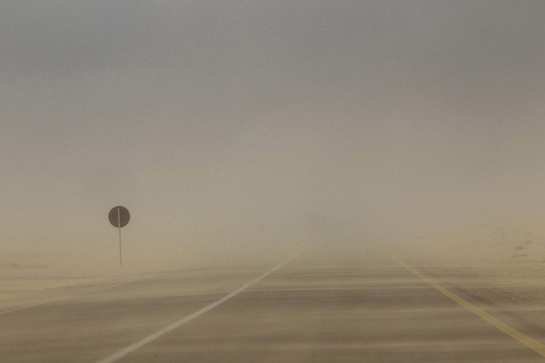 April 1, 2011. Sand blows across the coastal highway near Brega in eastern Libya.