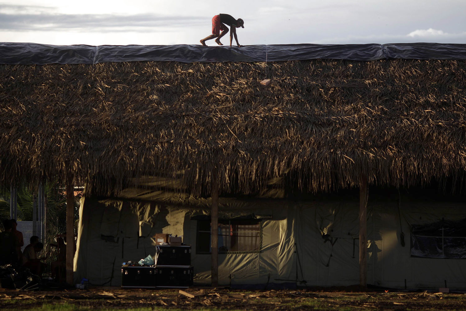 April 21, 2011. A man works on the roof of a campaign hospital built by the  Expedicionarios da Saude  (Brazilian Health Expeditions) on the first day of the medical expedition at the Kayapo tribe in Sao Felix, northern Brazil.