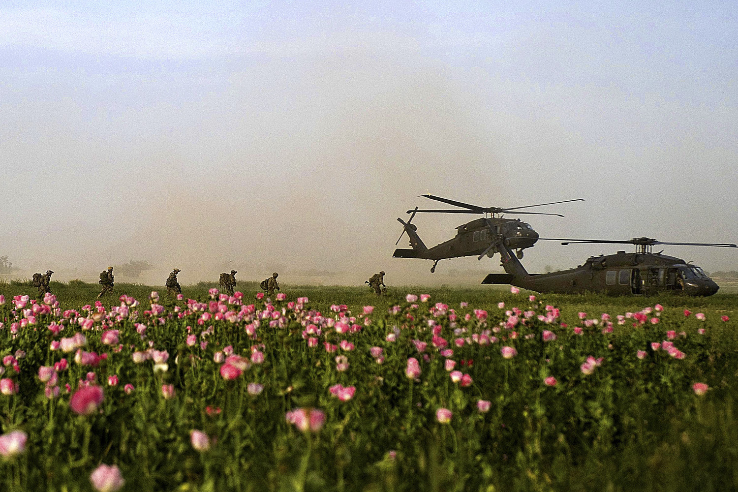 April 26, 2011. U.S. Special Operations service members with Special Operations Task Force South board two UH-60 Black Hawk helicopters following a clearing operation in Kandahar, Afghanistan.